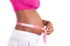 Young pregnant black woman measuring her belly - African people Royalty Free Stock Images