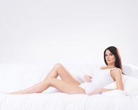 A young and pregnant brunette woman in lingerie Royalty Free Stock Images