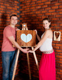 Young pregnant couple. Studio shoot Royalty Free Stock Photo