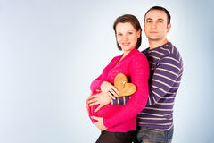 Young pregnant couple. The keys to happiness Royalty Free Stock Images