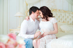 Young pregnant couple with baby booties for newborn boy Stock Images