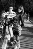 Young pregnant couple on bridge royalty free stock photo