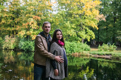 Young pregnant couple in a fall park Stock Photo