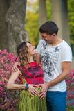 Young pregnant couple - forms heart shape with their hands Stock Image
