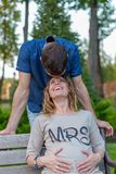 Young pregnant couple - laughing outdoor Royalty Free Stock Images