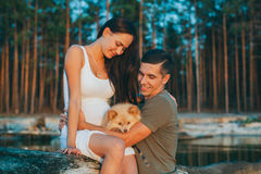 Young pregnant couple in love Stock Photography