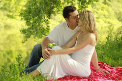 A young pregnant couple on nature Stock Images