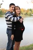 Young pregnant couple in park Royalty Free Stock Photos
