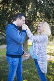 Young pregnant couple in park. Young pregnant couple in the park Stock Photos