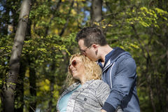 Young pregnant couple in park. Young pregnant couple in the park Stock Photo