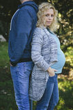 Young pregnant couple in park. Young pregnant couple in the park Royalty Free Stock Photography