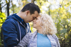Young pregnant couple in the park. Young loving pregnant couple in the park Stock Image