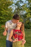 Young pregnant  couple at the park - with signs Royalty Free Stock Photography