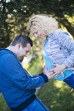 Young pregnant couple in the park. Young pregnant couple together in the park Royalty Free Stock Photography