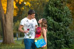 Young pregnant couple with rose Stock Photo
