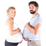 Young pregnant couple. Showing big stomach Royalty Free Stock Images