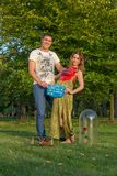 Young pregnant couple - with sign Stock Image