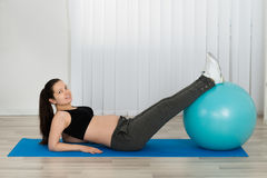 Young Pregnant Female Doing Workout Royalty Free Stock Photo