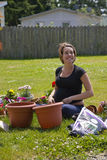 Young Pregnant Gardener Stock Images