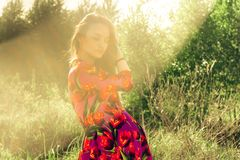 Pregnant girl in dress in nature. Young Pregnant girl in dress in nature royalty free stock image