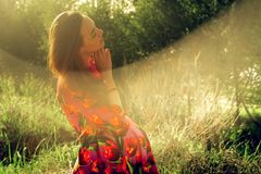 Pregnant girl in dress in nature royalty free stock photo