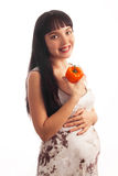 Young Pregnant Girl Is Eating Pepper. Stock Photo