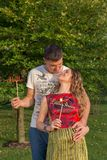 Young pregnant smiling couple outdoor at the summer park Stock Photos