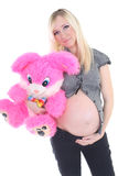 Young pregnant woman with big toy Stock Images