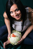 Young pregnant woman with cabbage Stock Image