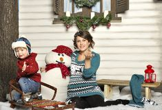 Young pregnant woman with the child about a snowman Stock Photo