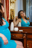 Young pregnant woman with cosmetic cream. Stock Photography