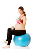 Young pregnant woman doing exercise at home Royalty Free Stock Photography