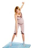 Young pregnant woman doing exercises Stock Photos