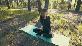 Young pregnant woman doing yoga outside. stock video