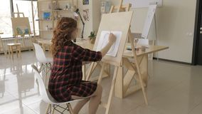 Young pregnant woman drawing painting in art studio, healthy happy lifestyle concept.  stock video