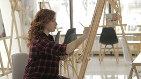 Young pregnant woman drawing painting in art studio, healthy happy lifestyle concept.  stock footage