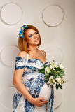 Young pregnant woman in fashionable dress Royalty Free Stock Photos