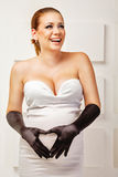 Young pregnant woman in fashionable dress Stock Photos