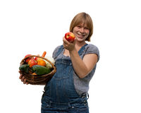 Young pregnant woman with a fruit basket Royalty Free Stock Photos