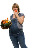 Young pregnant woman with a fruit basket Stock Images