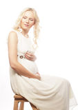 Young pregnant woman with gerber Stock Photo