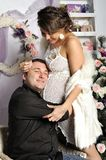 Young pregnant woman and happy father decorating Christmas tree Stock Photos