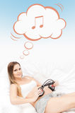 Young pregnant woman holding headphones on her belly Stock Photography