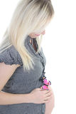 Young pregnant woman holding her Royalty Free Stock Photography