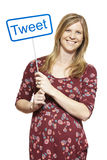 Young pregnant woman holding a social media sign smiling Stock Photo