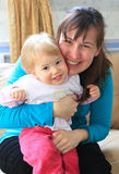Young pregnant woman hug her lovely child Stock Images