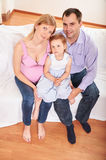 Young pregnant woman, with husband and little daughter Stock Image