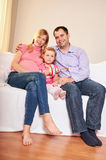 Young pregnant woman, with husband and little daughter Stock Images