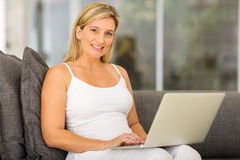 Young pregnant woman laptop Royalty Free Stock Image