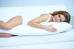 Young pregnant woman laying on sofa Royalty Free Stock Photo